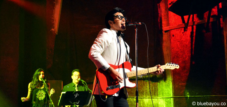 Dean Z as Buddy Holly during Elvis Week with his wife Stephanie in the background.